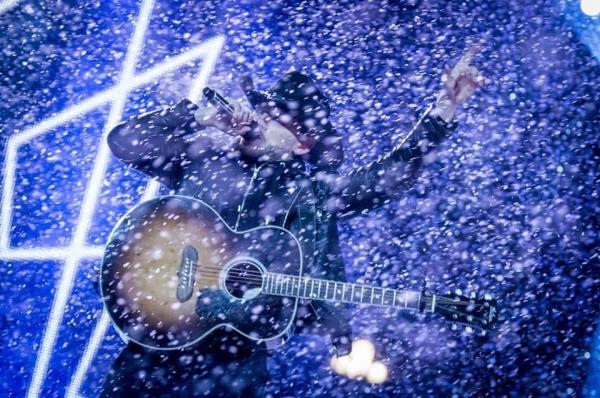 Country singer Brett Kissel performing through heavy snowfall.